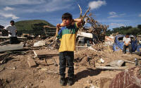 Child standing in the debris of Hurricane Mitch Tegucigalpa, Honduras  Tegucigalpa D.C., Honduras.